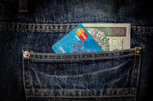 Credit card and money in a pocket