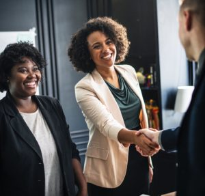 Professionals in moving company shake hands after good work