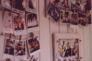 Family photos hung on a wall