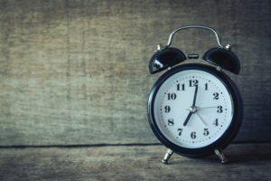 An alarm clock next to a wall