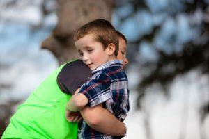 Two brothers hug