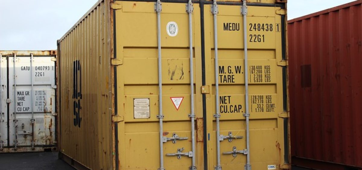 A picture containing a yellow storage container.