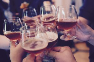 A group of people raising glasses.