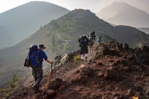 Group of people hiking as a way to adapt to life in California