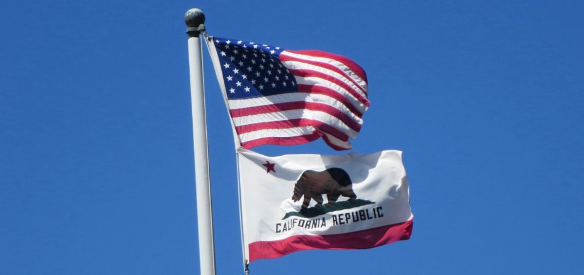 the flags of the USA and California