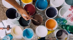 A lot of buckets with paint which you can use to make some changes after creating more space in your Florida beach house.