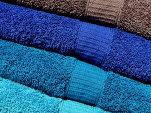 Towels in different colors you can use to protect your items before using portable storage containers.