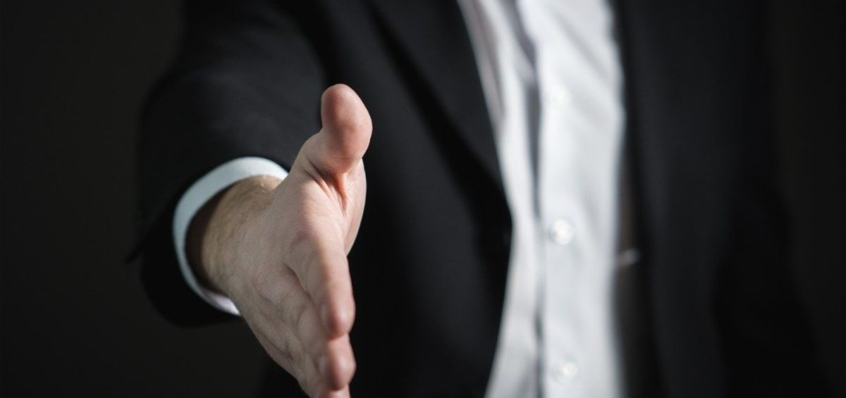 A man offering a hand for a handshake.