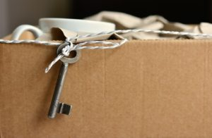 A cardboard box with some items packed and ready to go.