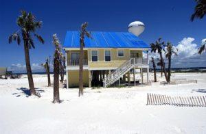 A small summer house on a beach.