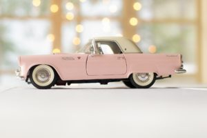 A model of a small pink car.