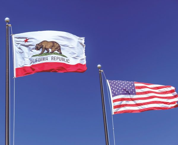The flags of the USA and California.