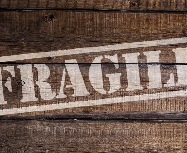 A wooden crate with the word fragile on it.