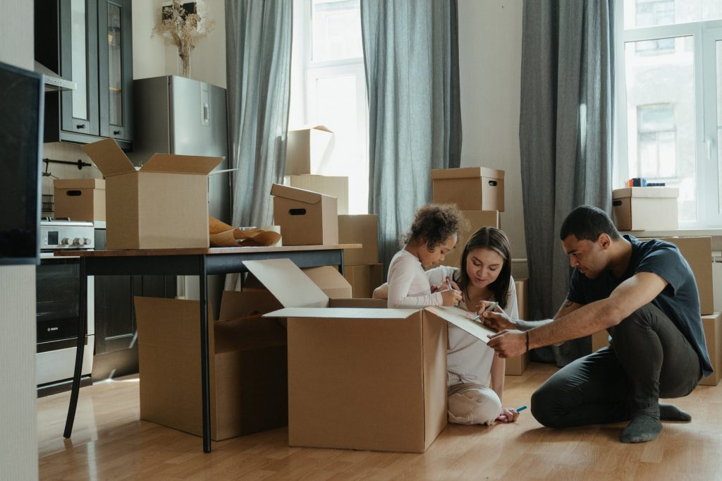 Family packing moving boxes
