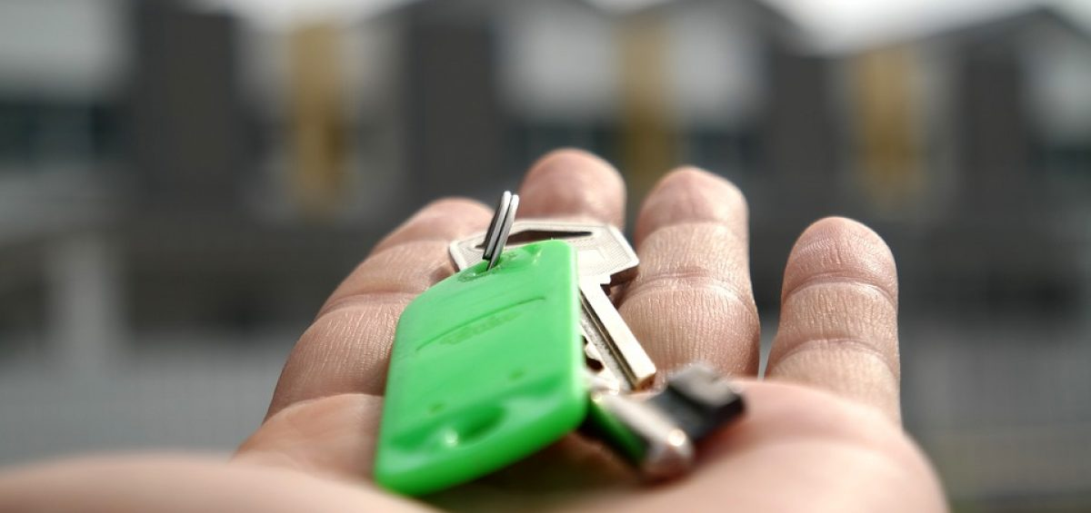 A person handing in the house keys.