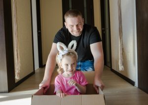 a father and daughter packing together