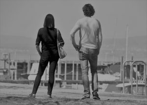 Two people standing.
