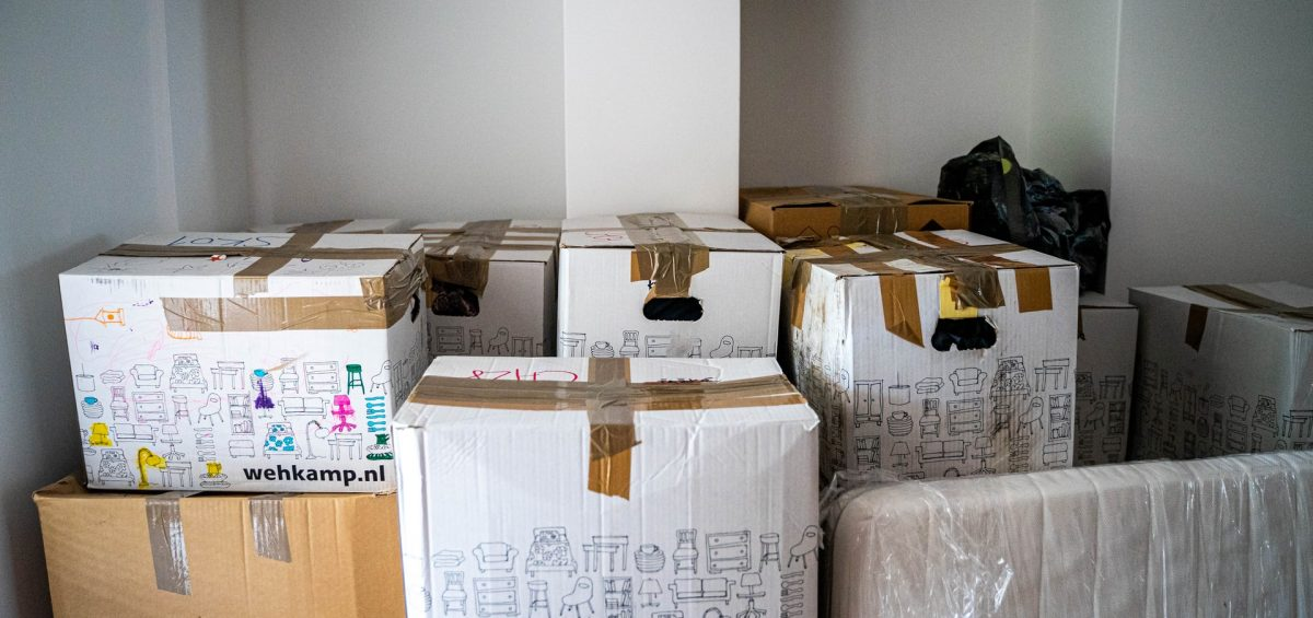 A pile of moving boxes once you pack your home in a day