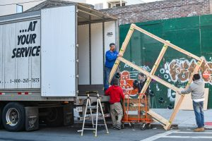 professional movers loading a moving truck after you pack your home in a day