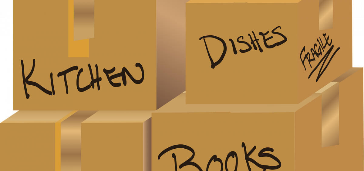 A pile of labeled cardboard boxes as an illustration of how to label your moving boxes